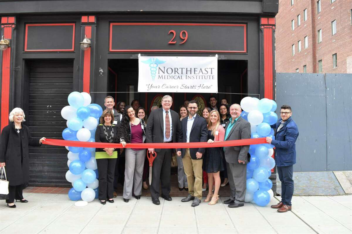 Mayor David Martin and several area officials and health-care professionals celebrated the new institute at a ribbon cutting on Monday, April 30, 2018.