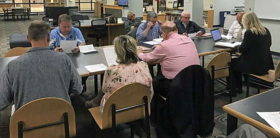 Cromwell officials tally the votes from Tuesday night's budget referendum. Photo: Jeff Mill / The Middletown Press