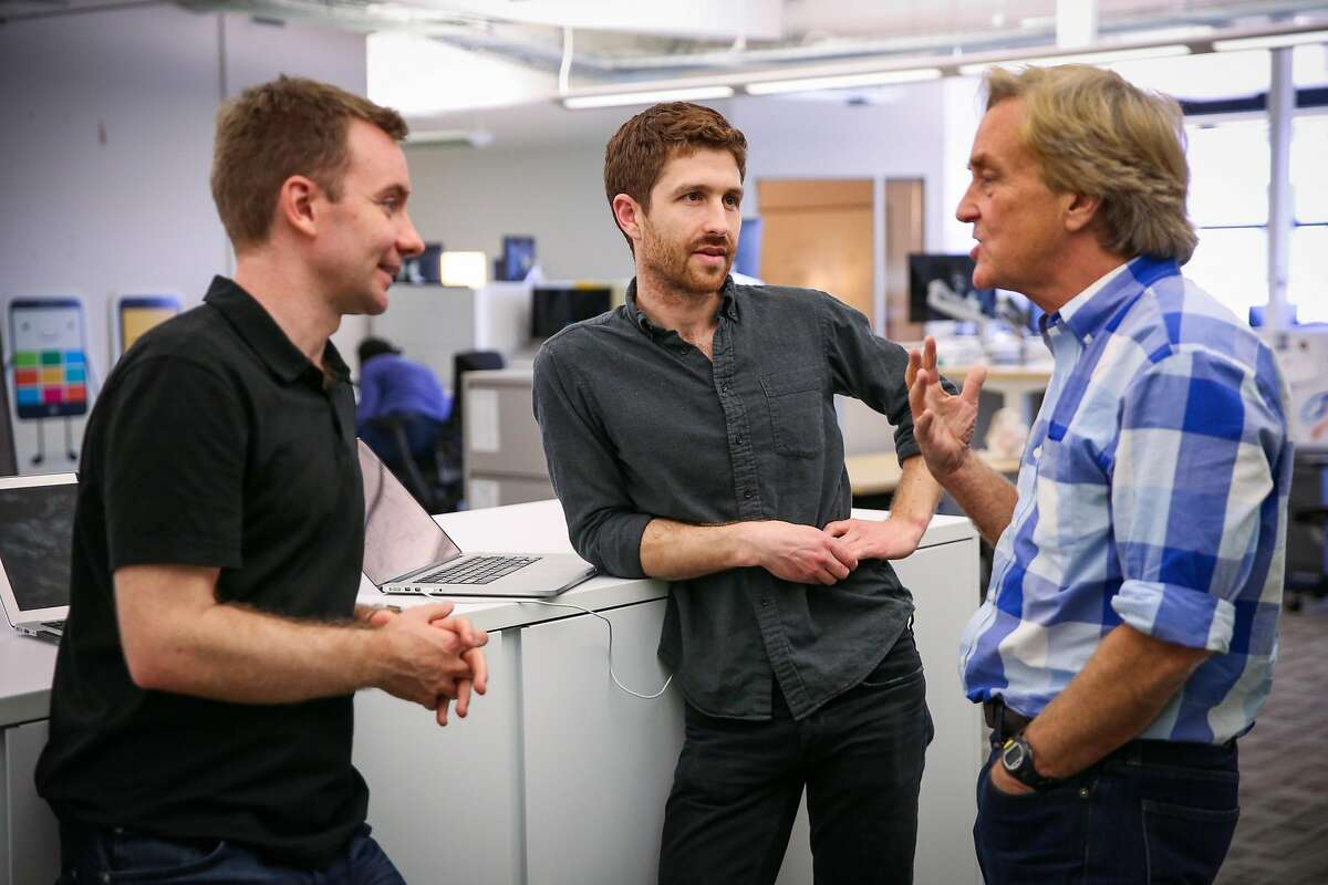 Tristan Harris (center), co-founder of the Center for Humane Technology chats with Sandy Parakilas (left) and Jim Steyer (right) ahead of a board meeting in San Francisco, California, on Tuesday, April 24, 2018.