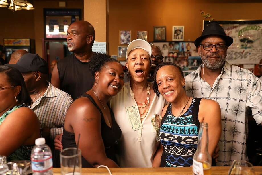 Cassie Nickelson (center), 80-year-old owner/chef of Scend's restaurant celebrating at her retirement party in Emeryville on July 22, 2017. On the left of Cassie is Nicole Scott, and the right of Cassie is Cassie's daughter, Debora Nickelson. Floyd Johnson (far right) is Debora's brother-in-law. Marshawn Lynch of the Oakland Raiders is opening a new restaurant in the former Scend's this week. Photo: Craig Lee / Special To The Chronicle