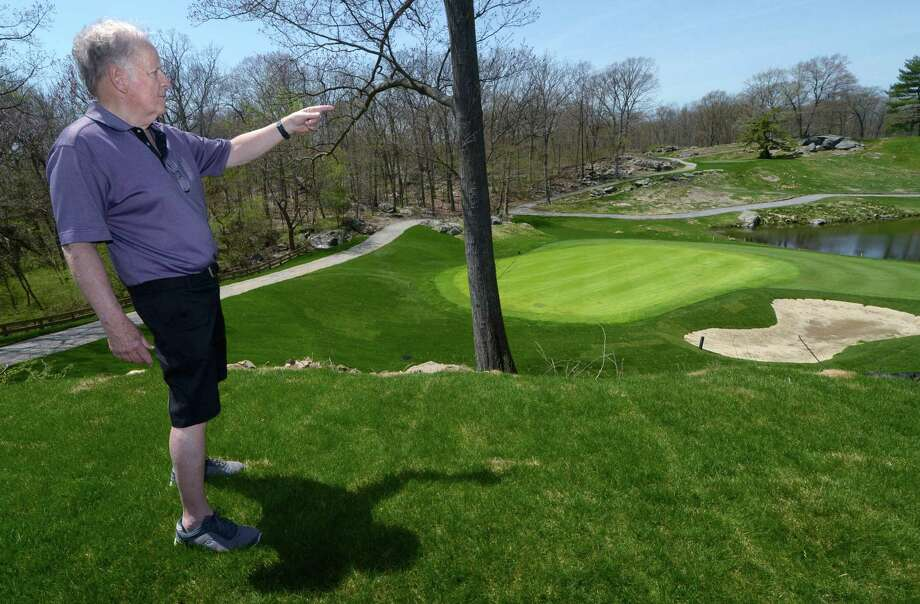 The Oak Hills Park Authority Chairman Jerry Crowley points out the soon to be completed third hole and fourth tee Wednesday, May 2, 2018, in Norwallk, Conn. The Oak Hills Park Authority officials are boasting that the 18-hole municipal golf course off Fillow Street in West Norwalk is in the best condition ever with one hole left for completion following a major capital improvement project. But the authority is still asking for relief from the city on paying back debt owed on construction of the golf course restaurant a decade ago. Photo: Erik Trautmann / Hearst Connecticut Media / Norwalk Hour