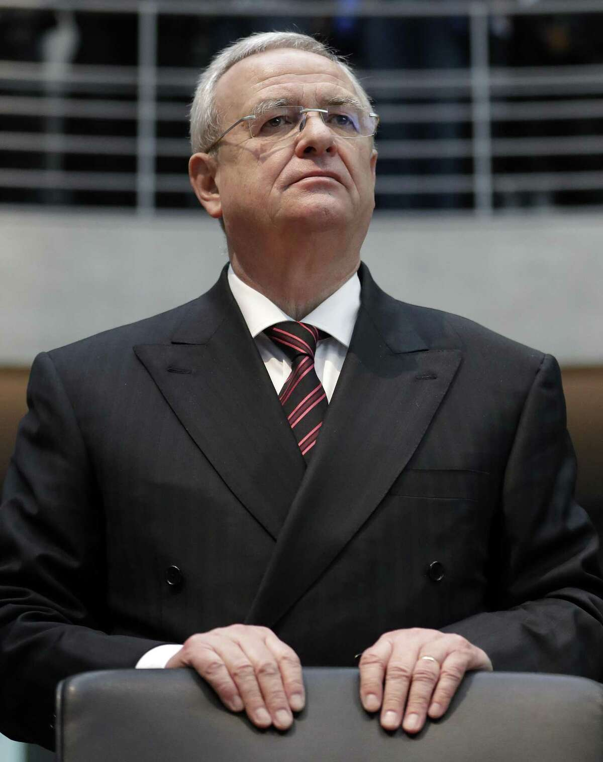 FILE - In this Jan. 19, 2017 file photo Martin Winterkorn, former CEO of the German car manufacturer 'Volkswagen', arrives for a questioning at an investigation committee of the German federal parliament in Berlin. A federal grand jury in Detroit has indicted former Volkswagen CEO Martin Winterkorn on charges stemming from the company's diesel emissions cheating scandal in a plot that prosecutors allege reached the top of the world's largest automaker. (AP Photo/Michael Sohn, file)