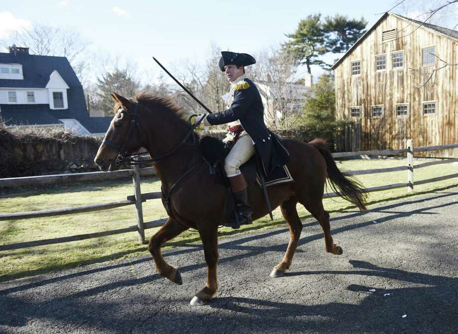 A photo from the annual reenactment of General Israel Putnam's ride at Putnam Cottage in Greenwich on Feb. 26, 2017. A group of about 20 reenactors from Connecticut's Fifth Regiment portrayed the 1779 scene of General Putnam and his small group of Continental Army soldiers staving off an attack by the British at Putnam Cottage. Photo: Tyler Sizemore / Hearst Connecticut Media / Greenwich Time