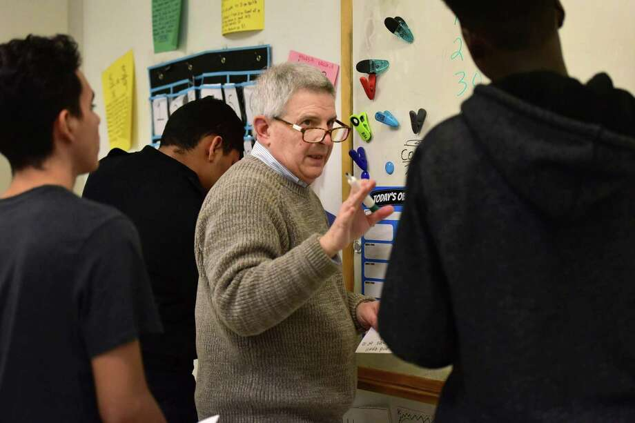 St. Paul's Episcopal Church volunteers including Bob Giolitto tutor students in math during the Norwalk International Academy Thursday, March 29, 2018, at Brien McMahon High School in Norwalk, Conn. The Norwalk International Academy is a program for newcomers to the US at the high schools. Photo: Erik Trautmann / Hearst Connecticut Media / Norwalk Hour