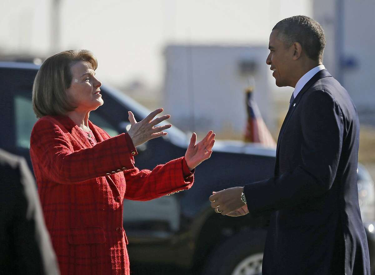 """FILE - In this Nov. 25, 2013 file photo, President Barack Obama and Sen. Dianne Feinstein, D-Calif., greet each other on the tarmac upon his arrival on Air Force One at San Francisco International Airport. Obama is backing Feinstein for re-election as she faces a challenge from within the Democratic party. The California senator released a statement from Obama Friday, May 4, 2018, calling Feinstein one of the """"most effective champions for progress."""" She's facing a challenge from state Sen. Kevin de Leon. (AP Photo/Pablo Martinez Monsivais, File)"""
