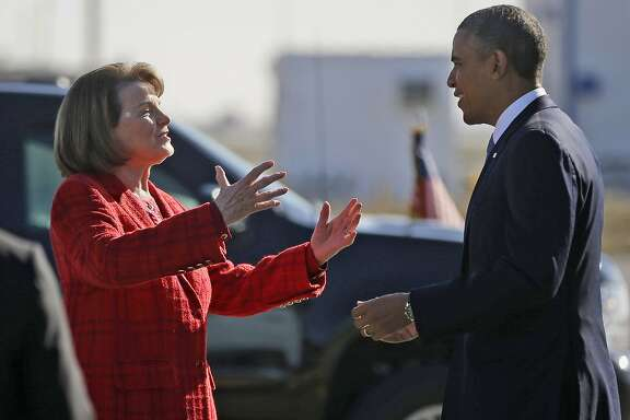 "FILE - In this Nov. 25, 2013 file photo, President Barack Obama and Sen. Dianne Feinstein, D-Calif., greet each other on the tarmac upon his arrival on Air Force One at San Francisco International Airport.  Obama is backing Feinstein for re-election as she faces a challenge from within the Democratic party. The California senator released a statement from Obama Friday, May 4, 2018, calling Feinstein one of the ""most effective champions for progress."" She's facing a challenge from state Sen. Kevin de Leon. (AP Photo/Pablo Martinez Monsivais, File)"