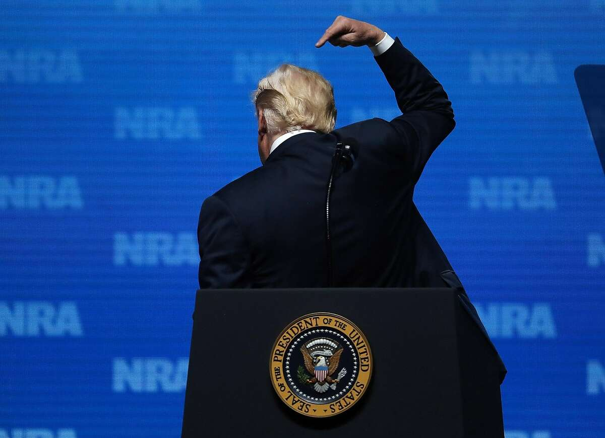 DALLAS, TX - MAY 04: U.S. President Donald Trump gestures as he speaks at the NRA-ILA Leadership Forum during the NRA Annual Meeting & Exhibits at the Kay Bailey Hutchison Convention Center on May 4, 2018 in Dallas, Texas. The National Rifle Association's annual meeting and exhibit runs through Sunday. (Photo by Justin Sullivan/Getty Images)