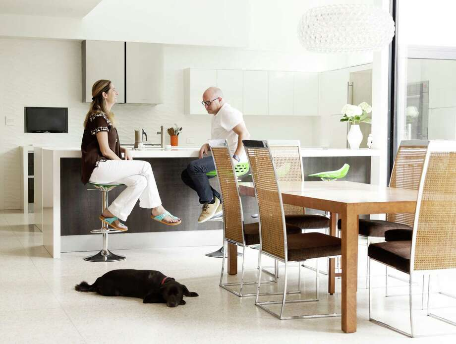 Claudia Farinola and Brad Dorsey relax in their Houston home with their dog, Lucky. The home was designed by Christopher and Vivi Robertson of Robertson Design. Photo: Jack Thompson / Jack Thompson / Jack Thompson Photography 2015