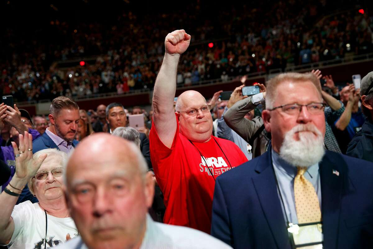 Attendees react as President Donald Trump addressed the National Rifle Association convention in Dallas, May 4, 2018. Trump began his remarks by hailing a number of Republican politicians in attendance, voicing full support for Sen. Ted Cruz in his bid for re-election. (Tom Brenner/The New York Times)