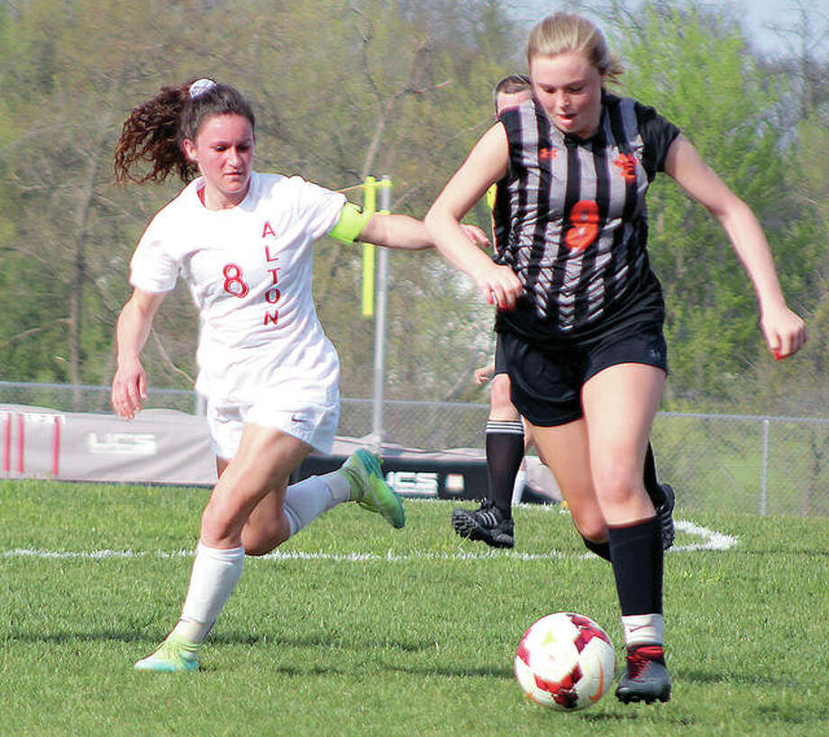 Paityn Schneider of Edwardsville, right, dribbles against Alton's Makayla Cox during Alton's 3-0 victory earlier this week at AHS. Edwardsville drew the top seed in Sub-Sectional A of the Normal Sectional and will face No. 8 Quincy in a semifinal of the Granite City Regional Tourney on May 15. Later that day, No. 5 Alton will face No. 4 and host Granite City. Photo:       Pete Hayes | The Telegraph