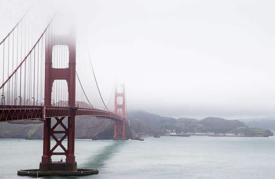The Golden Gate Bridge got a good going-over last week, with engineers rapeling down it towers for a thorough inspection. Photo: Jessica Christian / The Chronicle
