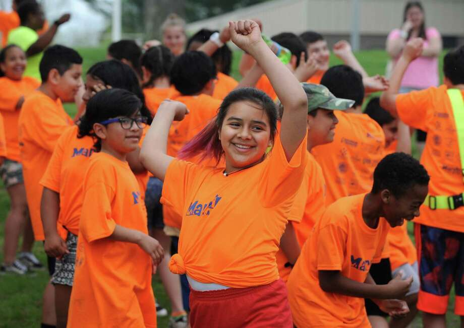 Marvin Elementary School 5th grader Valentina Velasquez warms up with Zumba before the school's walk-a-thon Friday, May 4, 2018, down Beach Road and around Shady Beach in Norwalk, Conn. The school had a fundraising goal of $10,000 and are just under $15,000 raised to date. Photo: Erik Trautmann / Hearst Connecticut Media / Norwalk Hour