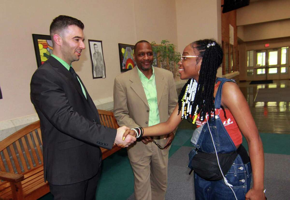 New Ansonia High School principal, Paul Giansanti, of Oxford, meets Des'Tahnee Manick-Highsmith, 16, as Giansanti takes part in a meet and greet with board of education members, friends and students at Ansonia High School in Ansonia, Conn., on Friday May 4, 2018. In back is Giansanti's old boss, Gary Highsmith. Highsmith hired Giansanti as Assistant Principal at Hamden High where Highsmith was principal. Giansanti will take over as principal of Ansonia High on July 1st.