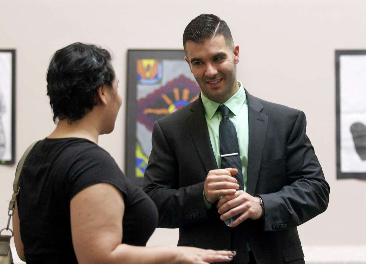 New Ansonia High School principal, Paul Giansanti, of Oxford, chats with Melanie Santiago as Giansanti takes part in a meet and greet with board of education members, friends and students at Ansonia High School in Ansonia, Conn., on Friday May 4, 2018. Giansanti will take over as principal of Ansonia High on July 1st.
