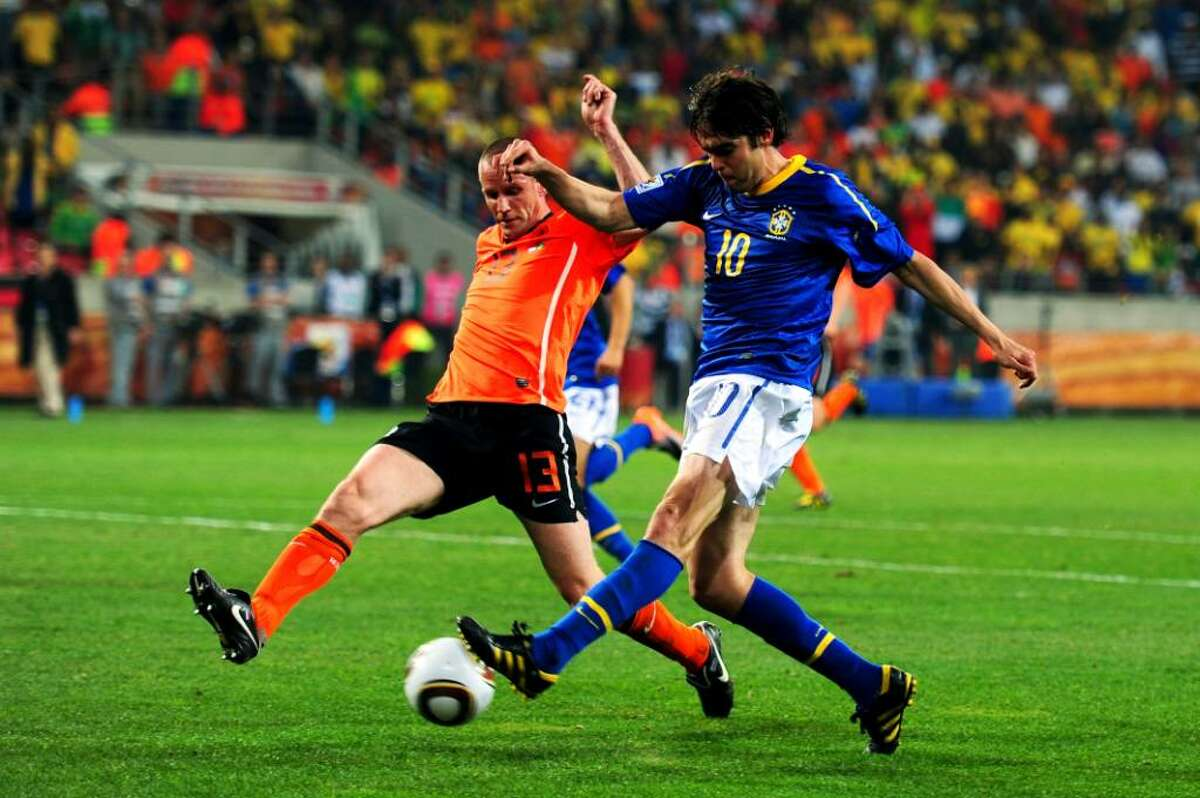 PORT ELIZABETH, SOUTH AFRICA - JULY 02: Andre Ooijer of the Netherlands challenges Kaka of Brazil during the 2010 FIFA World Cup South Africa Quarter Final match between Netherlands and Brazil at Nelson Mandela Bay Stadium on July 2, 2010 in Nelson Mandela Bay/Port Elizabeth, South Africa. (Photo by Laurence Griffiths/Getty Images) *** Local Caption *** Andre Ooijer;Kaka