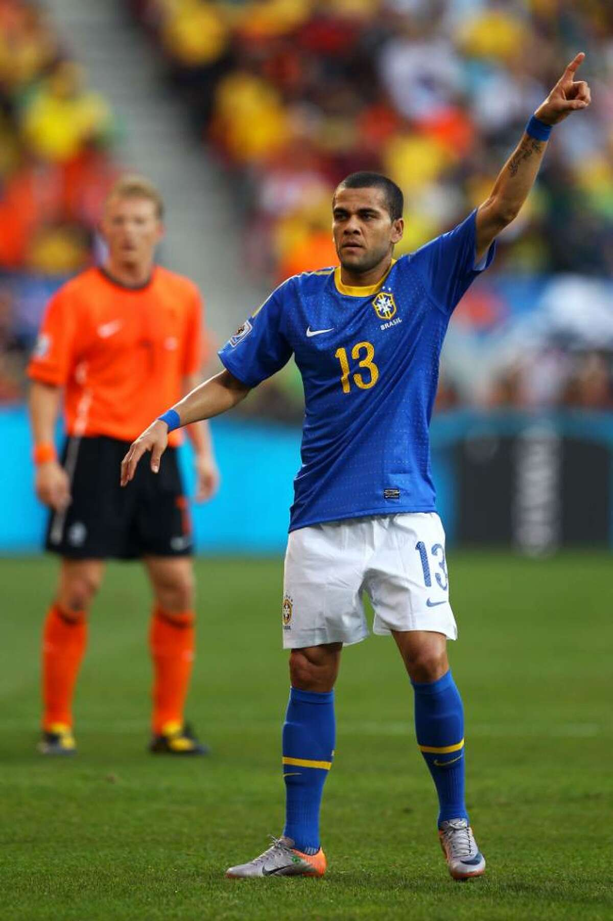 PORT ELIZABETH, SOUTH AFRICA - JULY 02: Dani Alves of Brazil gestures during the 2010 FIFA World Cup South Africa Quarter Final match between Netherlands and Brazil at Nelson Mandela Bay Stadium on July 2, 2010 in Nelson Mandela Bay/Port Elizabeth, South Africa. (Photo by Richard Heathcote/Getty Images) *** Local Caption *** Dani Alves