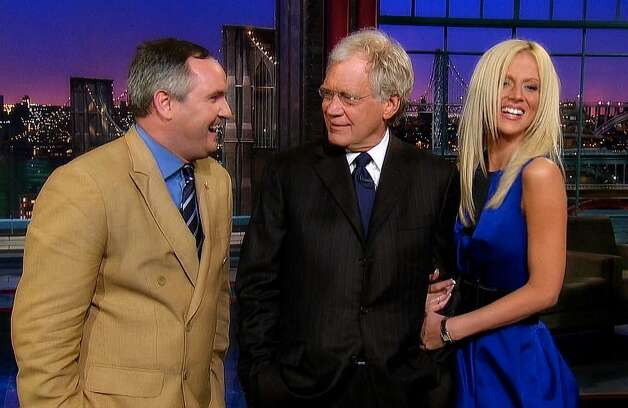 """In this image taken from video and provided by Worldwide Pants Inc., Accused White House 'party crashers,' Tareq Salahi and Michaele Salahi """"crash"""" David Letterman's (C) monologue during a surprise appearance on """"The Late Show With David Letterman"""" on May 25, 2010 in New York City.  Episode Airs: May 25, 2010 (11:35 PM, ET/PT) on the CBS Television Network. ©2010 Worldwide Pants Inc. All Rights Reserved. Photo: Ho, CBS / 2010 CBS Broadcasting Inc."""