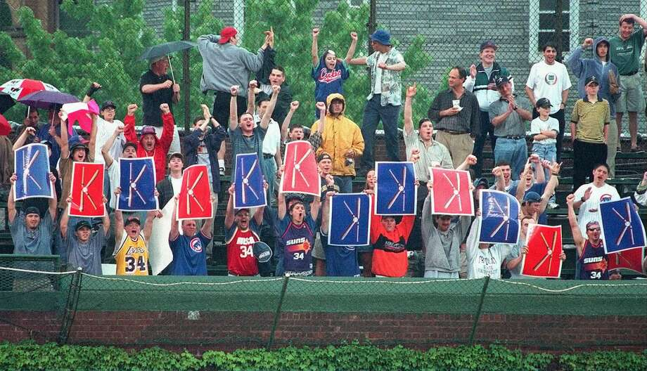 The Cubs' Kerry Wood kept fans in the Wrigley Field bleachers busy flashing 'K' signs as he tied the MLB record for strikeouts in a nine-inning game with 20 against the Astros on May 6, 1998. Photo: RICHARD A. CHAPMAN, AP / CHICAGO SUN-TIMES