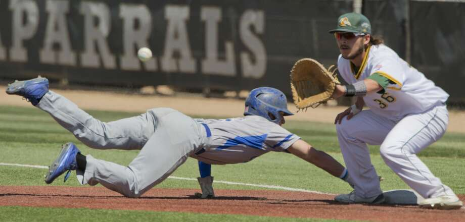 Odessa College's Wade Raburn dives back to first to beat the pickoff throw to Midland College's Braden Scrivner 05/04/18 in the second game of a double header at Christensen Stadium. Tim Fischer/Reporter-Telegram Photo: Tim Fischer/Midland Reporter-Telegram