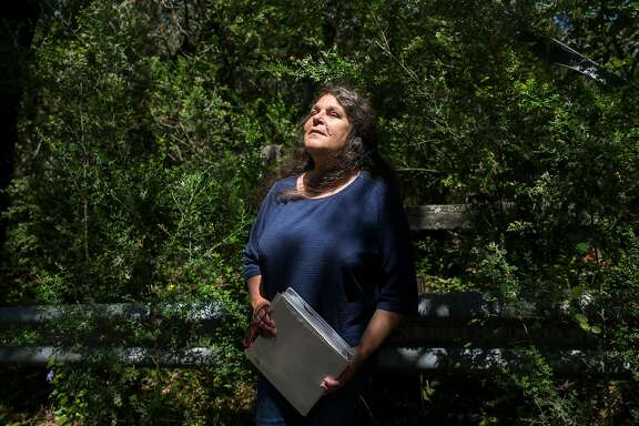 Debora Silva poses for a portrait Thursday, May 3, 2018 in Glen Ellen, Calif. while searching for the spot on Enterprise Road where the body of Kim Allen was found.