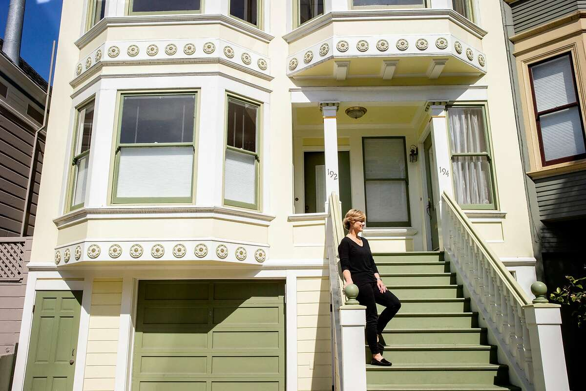 Linda Crowe stands for a portrait outside her new home, Thursday, May 3, 2018, in San Francisco, Calif.