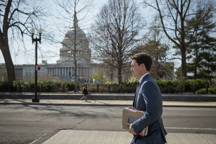 Brent Sullivan, outside the United States Capitol, works as a headhunter on the Hill. He is also a blue-collar work-boot-wearing firewood seller, delivering to restaurants and private homes in the metro area. Photo: Photo For The Washington Post By Evelyn Hockstein / Evelyn Hockstein
