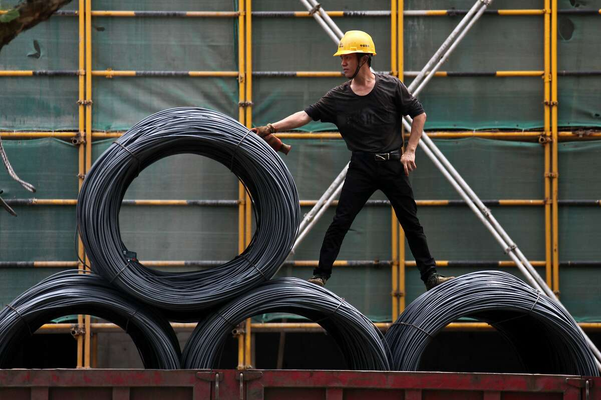 This photo taken on April 30, 2018 shows a worker moving reels of steel cable at a construction site in Nanjing, in China's eastern Jiangsu province. The first salvos in the budding US-China trade conflict struck old-school sectors like steel and agriculture, but Beijing is now bracing for moves against its strategic ambitions in hi-tech. / AFP PHOTO / - / China OUT-/AFP/Getty Images