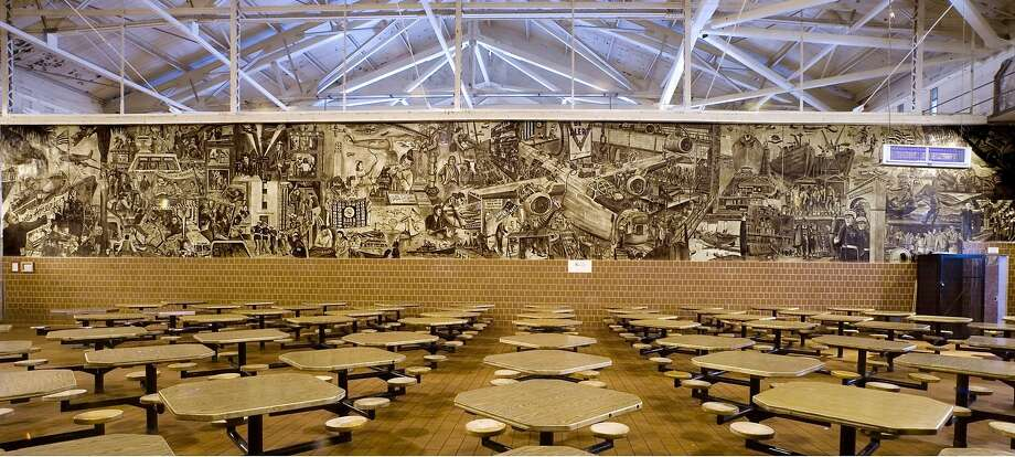 """(NYT41) SAN QUENTIN, Calif. -- Aug. 15, 2007 -- ART-PRISONER-MURALS-ADV19 -- A mural painted by Alfredo Santos, while an inmate, at San Quentin, in San Quentin, Calif., Aug. 9, 2007. """"San Quentin is where I became an artist,"""" Alfredo Santos says now, more than half a century after he painted the mural and five others in the dining hall. (Peter DaSilva/The New York Times) Ran on: 08-26-2007 Murals depicting a populist vision of California history decorate walls of the dining hall in San Quentin State Prison. They were created by Alfredo Santos more than 50 years ago when he was an inmate. Ran on: 08-26-2007 Murals depicting a populist vision of California history decorate walls of the dining hall in San Quentin State Prison. They were created by Alfredo Santos 50 years ago when he was an inmate. Photo: Peter DaSilva;Peter Dasilva / New York Times"""