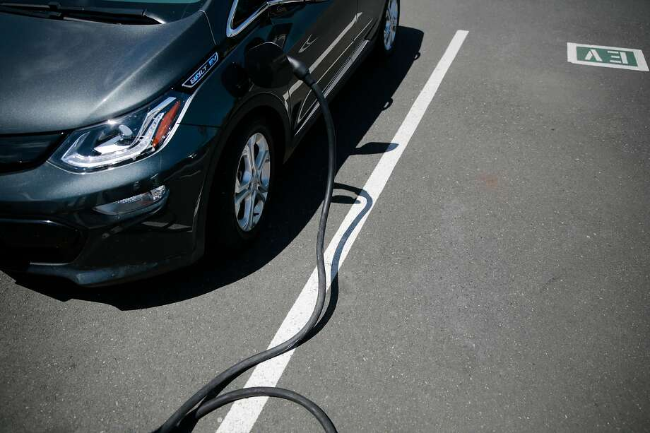 A 2017 Chevy Bolt electric vehicle is charged at the Jim Bone Kia dealership in Santa Rosa, California, Thursday, May 3, 2018. Ramin Rahimian/Special to The Chronicle Photo: Ramin Rahimian / Special To The Chronicle
