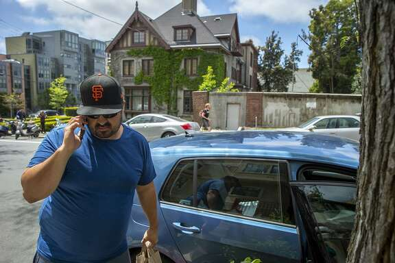 Aaron Powell calls his client who ordered food through the Doordash app, Thursday, May 3, 2018, in Berkeley, Calif.
