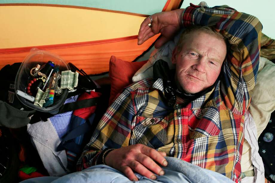 Oscar McKinney, homeless since 1985, in his tent on 13th Street. Photo: Lea Suzuki / The Chronicle