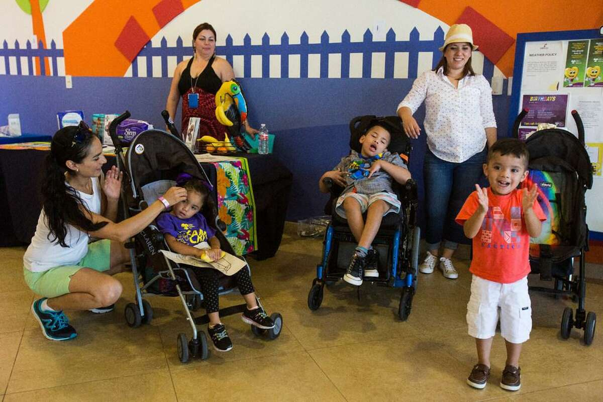Attendees watch a dance skit performed by ECYD Mission Corps during Camp CRIT, a weeklong program for patients and their families, at the Children's Rehabilitation Institute in San Antonio in 2016. The institute offers unique services for special needs children.