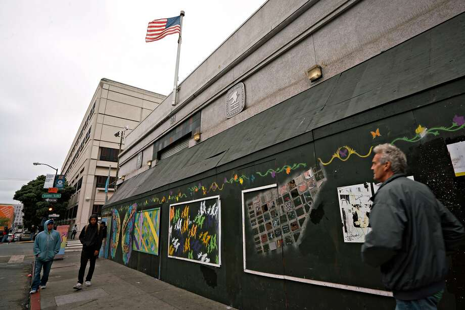 People pass by the former post office at 101 Hyde Street slated to convert into a food incubator and culinary hall in San Francisco's Tenderloin district on Thursday, May 3, 2018. Photo: Sarahbeth Maney / Special To The Chronicle