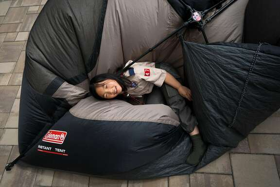 Jordan Fong, 8, lies on top of a tent in the backyard of her home in San Francisco, Calif. on Thursday, May 3, 2018.