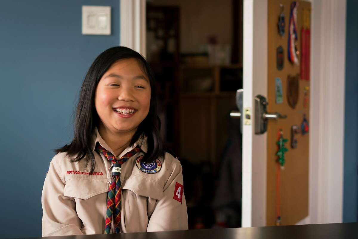 Jordan Fong, 8, smiles while wearing her Boy Scout uniform at her home in San Francisco, Calif. on Thursday, May 3, 2018.