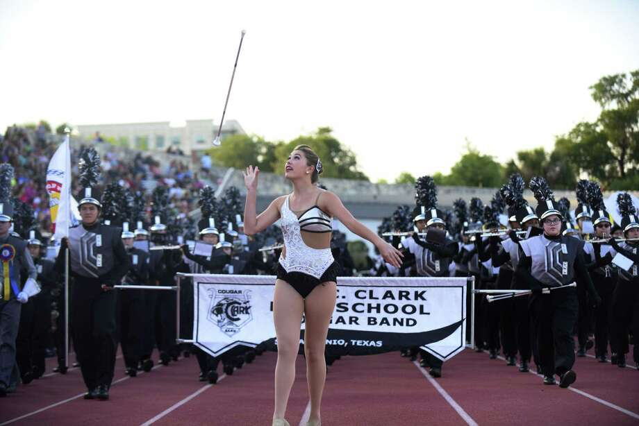 Something San Antonio's Fiesta and Tricentenniel celebrations demonstrate? Our niceness. The Clark High School band, led by a drum major, perform during the Battle of Flowers Association's annual band festival at Alamo Stadium on April 26. Photo: Billy Calzada /San Antonio Express-News / San Antonio Express-News