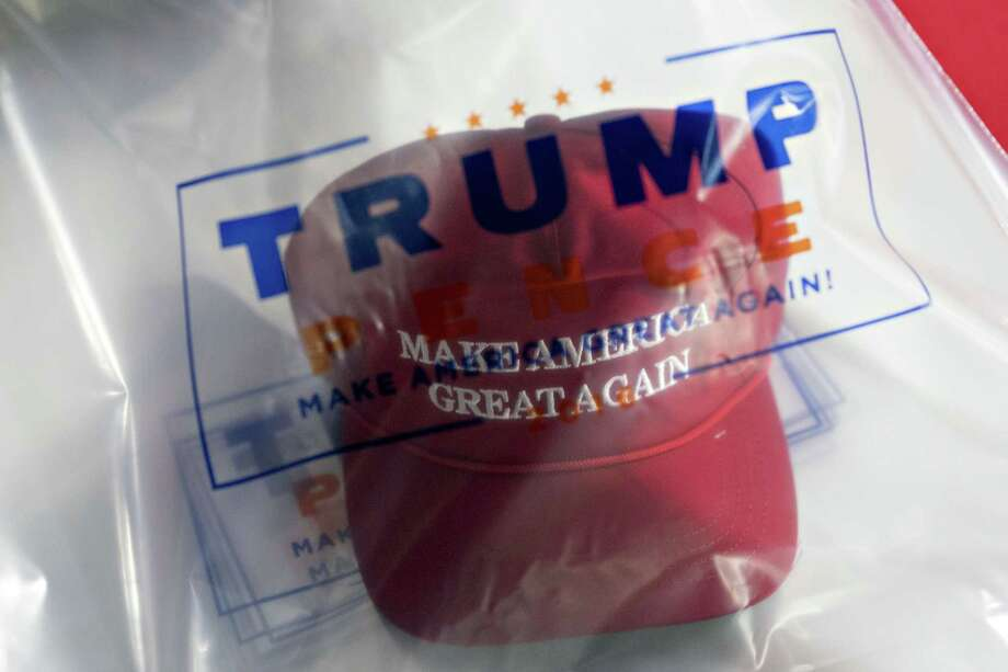 A campaign hat sits inside a bag on a table during a rally in Washington, Michigan on April 28. The slogan is emblematic of much that troubles Trump voters — change — while embracing a resistance based on nostalgia for how things were. Photo: Daniel Acker /Bloomberg / © 2018 Bloomberg Finance LP