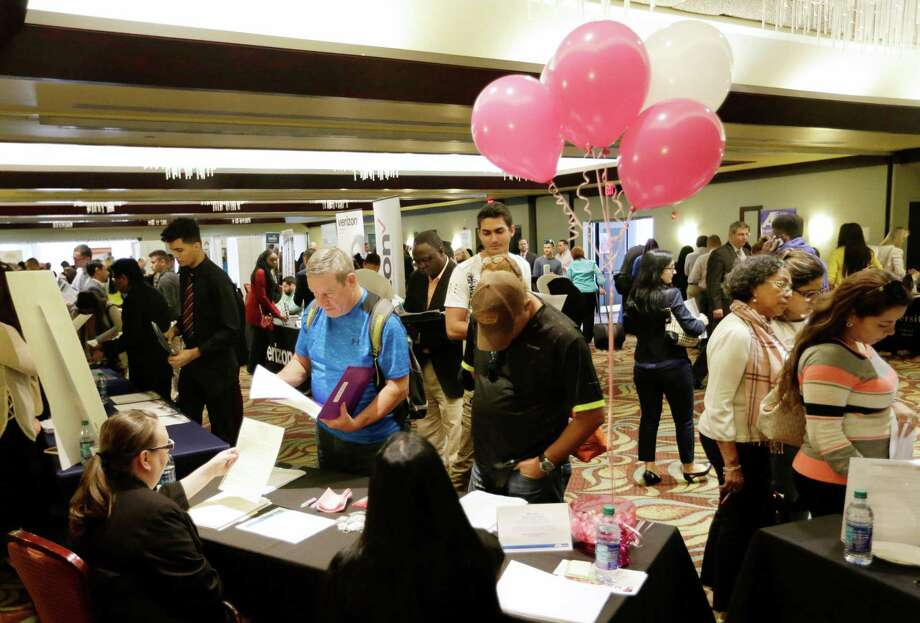 In this Jan. 30, 2018, file photo, job applicants talk with employees of Hialeah Park, at a JobNewsUSA job fair in Miami Lakes, Fla. The Labor Department on Friday said the nation's unemployment rate was 3.9 percent, a 17-year low. Photo: Lynne Sladky /Associated Press / Copyright 2018 The Associated Press. All rights reserved.