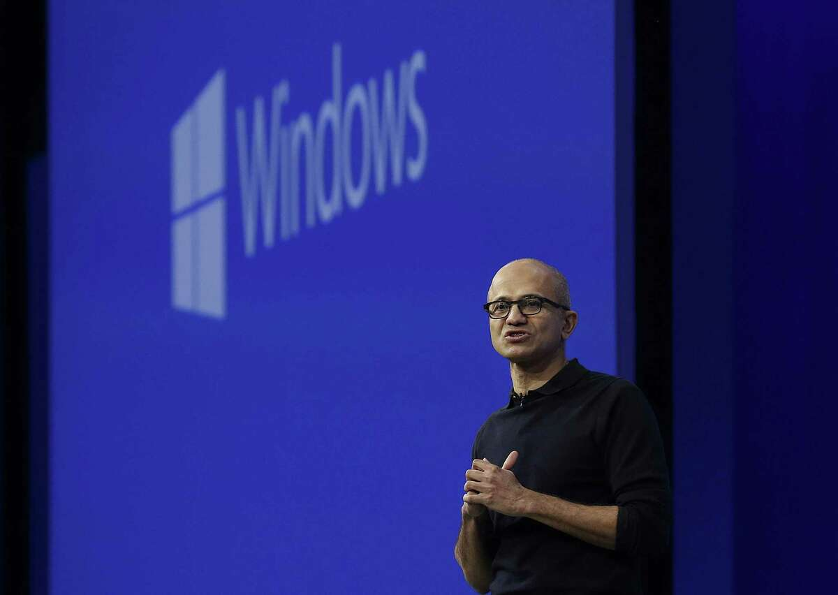 Microsoft CEO Satya Nadella speaks about Windows at the annual Microsoft Build conference in San Francisco, Wednesday, April 29, 2015. While Microsoft has already previewed some aspects of the new Windows 10, a parade of top executives will use the conference to demonstrate more software features and app-building tools, with an emphasis on mobile devices as well as PCs. (AP Photo/Jeff Chiu)