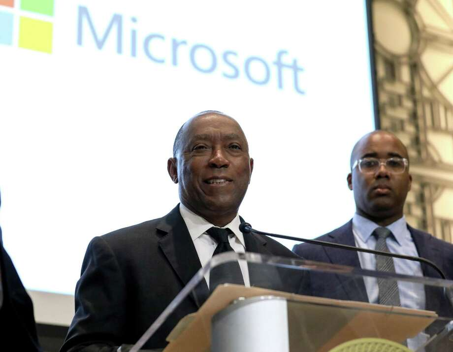Houston Mayor Sylvester Turner, left, and Raamel Mitchell, director of citizenship and public affairs at Microsoft, announce Friday a partnership between Microsoft and the city of Houston on a wide-ranging technology agreement. Photo: Jon Shapley, Houston Chronicle / Houston Chronicle / © 2018 Houston Chronicle