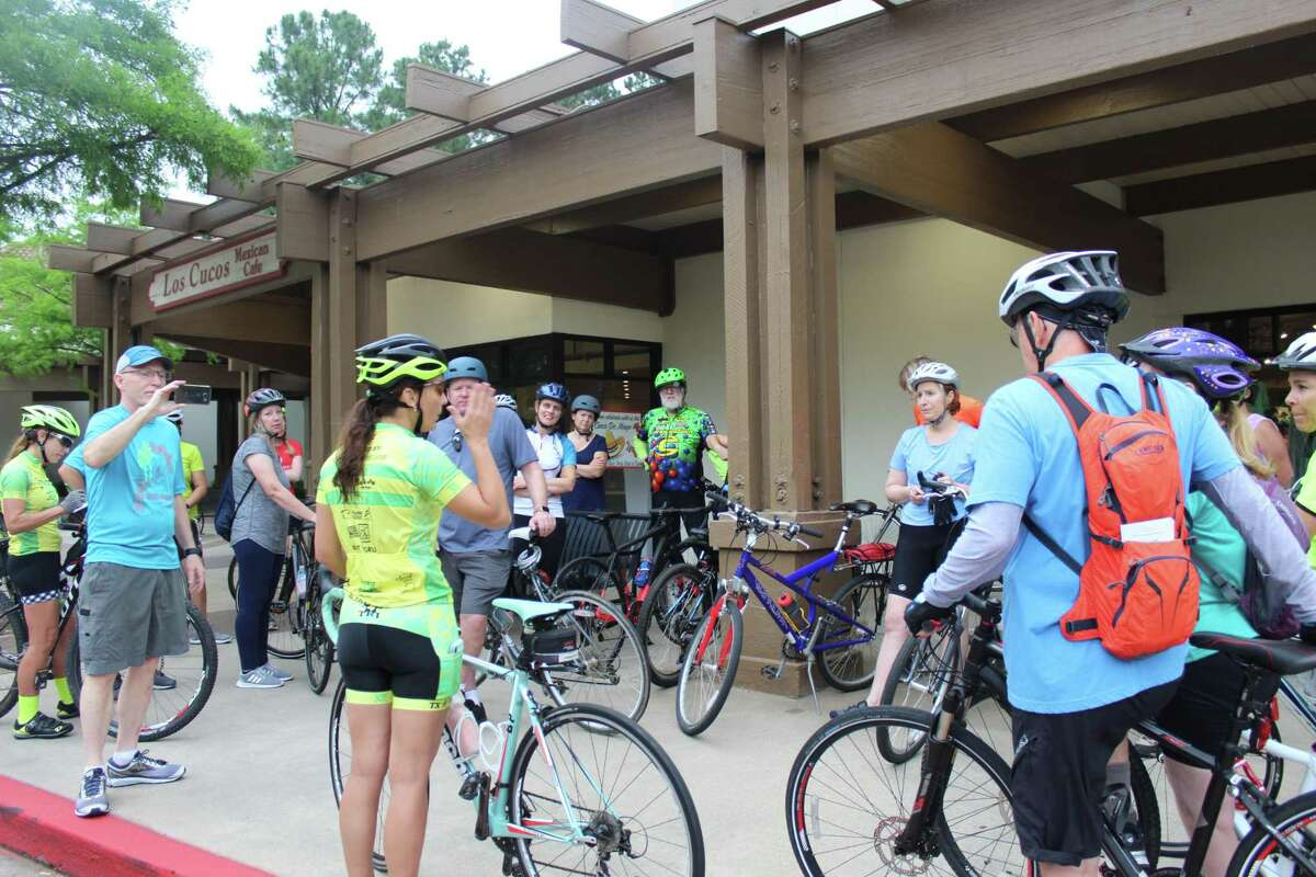 In this Villager archive photograph, Bike The Woodlands Coalition's Fernanda Suarez gives a brief safety and rules of the road lecture to cyclists gathered in the Panther Creek Shopping Center on Thursday, May 3, for the first of the Discover the Villages bike tours TXTRI in The Woodlands is hosting for National Bike Month. Randall Cade, the current president of the coalition, said he advised that road bicyclists should stay as far right in lanes as possible for both safety and also to not slow down traffic, to use shoulders when they are present and also wear a helmet, bright clothing and outfit bicycles with electrical battery-powered lights. Riding in groups can also help promote safety and visibility when on the road.