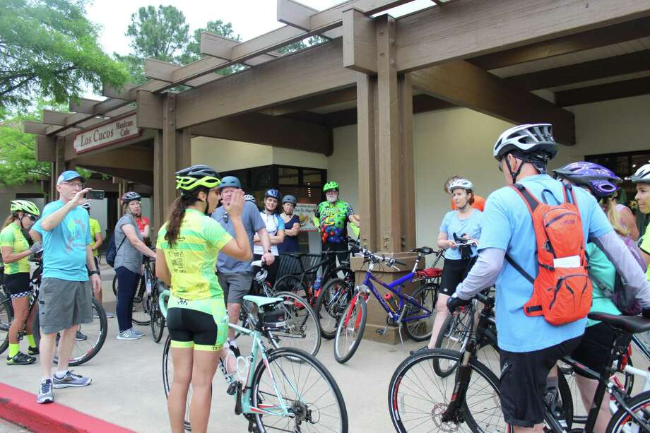 In this Villager archive photograph, Bike The Woodlands Coalition's Fernanda Suarez gives a brief safety and rules of the road lecture to cyclists gathered in the Panther Creek Shopping Center on Thursday, May 3, for the first of the Discover the Villages bike tours TXTRI in The Woodlands is hosting for National Bike Month. Randall Cade, the current president of the coalition, said he advised that road bicyclists should stay as far right in lanes as possible for both safety and also to not slow down traffic, to use shoulders when they are present and also wear a helmet, bright clothing and outfit bicycles with electrical battery-powered lights. Riding in groups can also help promote safety and visibility when on the road. Photo: Patricia Dillon / The Woodlands Villager