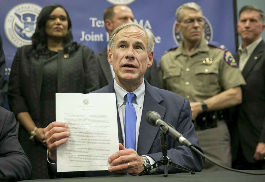 Texas Gov. Greg Abbott speaks about Hurricane Harvey recovery efforts at a news conference at the Texas FEMA Joint Field Office in Austin, Texas, on Sept. 26, 2017. Photo: Jay Janner, MBO / Associated Press / Austin American-Statesman