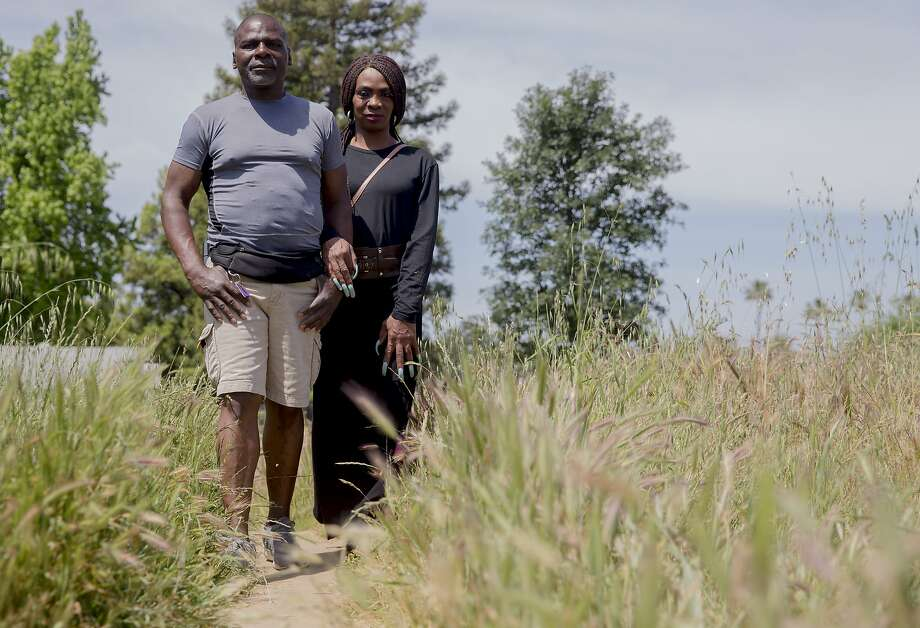 Tanesh Nutall with her husband, Pierre Nutall, at Jan Park near their home in Carmichael (Sacramento County). Photo: Jessica Christian / The Chronicle
