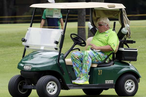 John Daly takes a smoke break in a cart on the 6th green during the first round of the Insperity Invitational at the The Woodlands Country Club Friday, May 4, 2018, in The Woodlands, TX. (Michael Wyke / For the Chronicle)