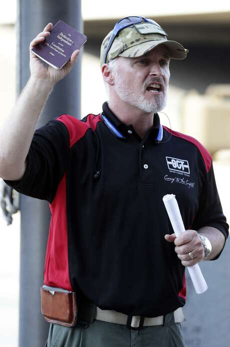 President and CEO CJ Grisham cites his U.S. Constitution as Texas Open Carry demonstrators gather on the steps of the Austin Police Department to take issue with Police Chief Art Acevedo's stance on the topic of firearm carrying on May 6, 2015. Photo: Tom Reel / San Antonio Express-News