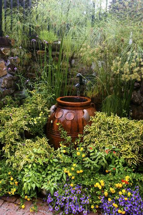 A backyard fountain adds soothing sounds, and the statuary can serve as a garden focus. Photo: Dean Fosdick, STR / AP / AP