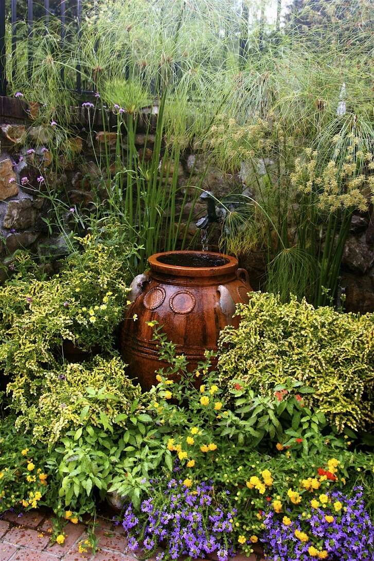 A backyard fountain adds soothing sounds, and the statuary can serve as a garden focus.