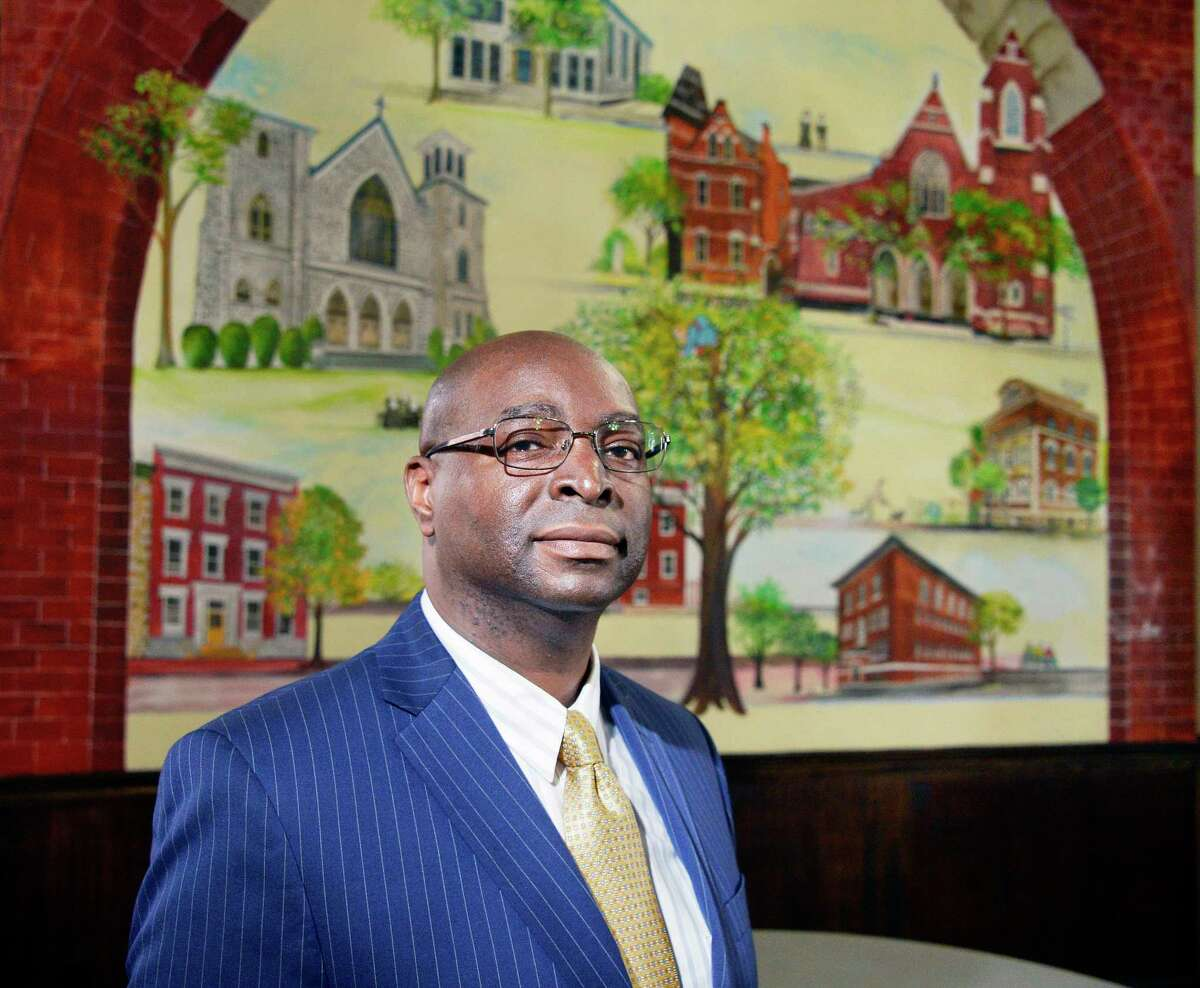Rev. David Gordon before a mural of the South End at St. John-St. Anne Outreach Center Wednesday May 2, 2018 in Albany, NY. (John Carl D'Annibale/Times Union)
