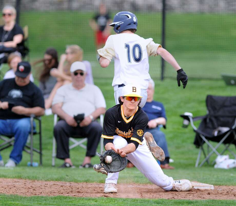 Ethan Anderson of King beats out an infield hit as Brunswick first baseman Cole Mascolo takes the late throw Friday at Brunswick. King won 7-3. Photo: Bob Luckey Jr. / Hearst Connecticut Media / Greenwich Time